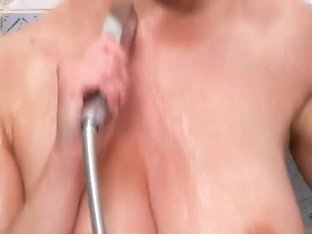 Busty redhead Vanessa polishes twat under shower