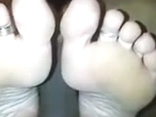 I'm getting a footjob in amateur interracial porn clip