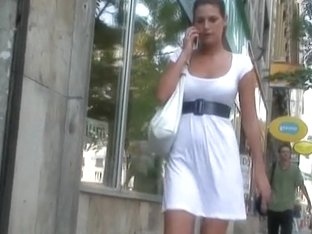 Hot philander caught on voyeur's cam in a sexy dress