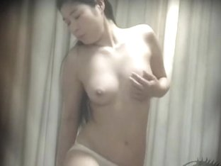 Asian girl masturbates by riding a furniture piece at home