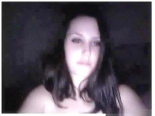 Brunette girl fools around naked in her bedroom