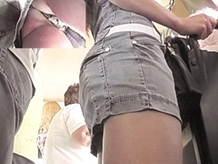 Sassy jeans upskirt in a bus