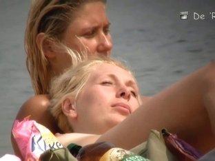 Mature hotties filmed by a nude beach pervert