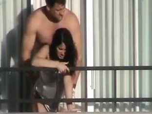 Girl fucked from behind on the balcony