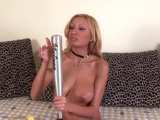 Trisha is pleasing herself with a baseball bat