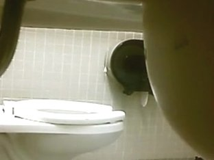 Public toilet voyeur surprise !!! did she buttplug her ass ???