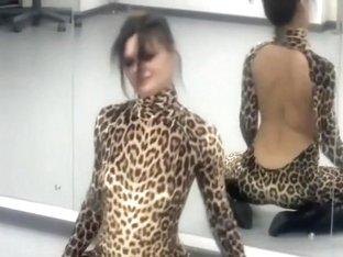 Girlfriend dressed in a leopard catsuit