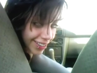 Beautiful avid emo tattoe female bonks the car gearstick in a public place,damn