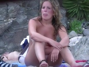 Zooming on a nudist girl's shaved pussy