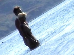 Naked chicks swimming in the sea on a nudist beach
