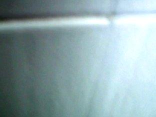 An alluring Asian chick caught on hidden camera