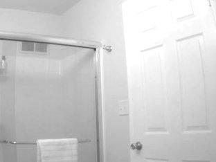 Lovely babe takes a bath on a voyeur's camera