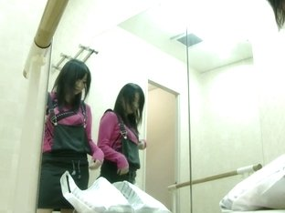 A spy camera in changing room takes a full view of an Asian changing her clothes