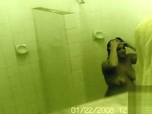 Two good looking babes get caught on camera showering