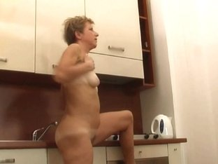 Over 60 granny acquires herself off in the kitchen
