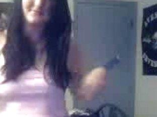 Cute brunette talking to her boyfriend on cam strips for him