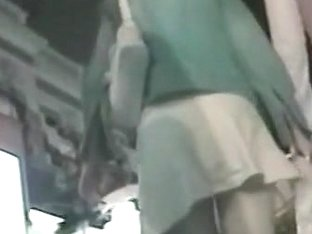 Slutty woman in a white skirt caught on a hidden cam