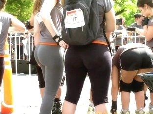 Sports girls in tight pants run cross on the street