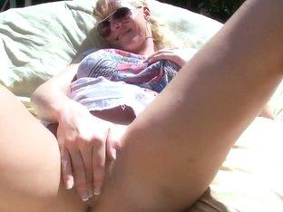 Brittanie Lane fingering her pussy outdoor