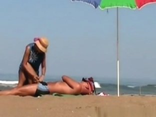 Wife handjob at beach