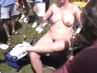 Naked blonde woman flashes breasts and crotch in the park