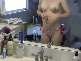 My girlfriend with perky tits puts on her bikini