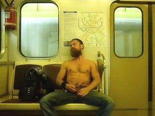 Bearded Russian guy rubs his big dick on the subway
