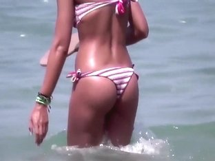 Brunette at the beach filmed as she provides pure beauty