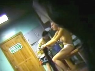 Spy cam in dressing room shoots half nude girl in distance