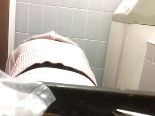 Well hidden camera shot a female's back while pissing