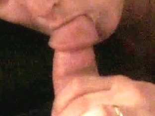 Brunette chick sucks a dick