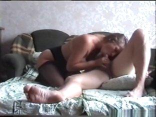 Milf with sex lingerie fucks her man in the bedroom