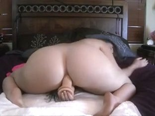 PAWG plunging big dildo into her ass and mouth