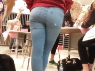 Sexy ass of a schoolgirl in jeans