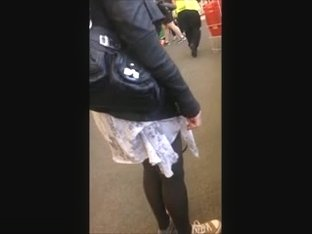 Cougar in stockings & mini skirt at the store.