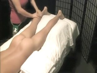 Masseuse rubs her client's ass and erected penis