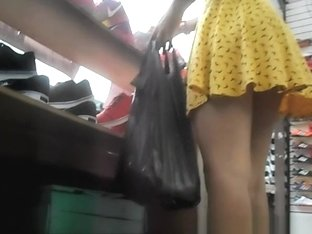 Asian yellow dress upskirted
