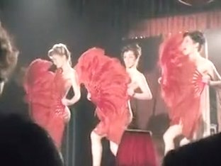 Cabaret performers get naked and dance on the stage