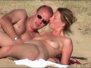 Ukrainian milf fucked on the beach by her horny husband