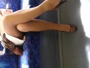 Woman with dandling legs in metro