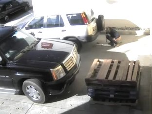 Chubby woman takes a huge poop behind a parked car