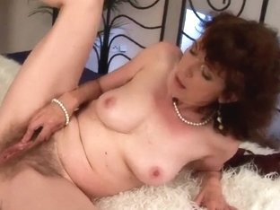 Old woman with furry cookie acquires drilled