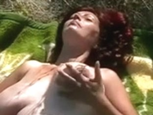 Huge-Boobs-MILF Outdoors on a Summerday
