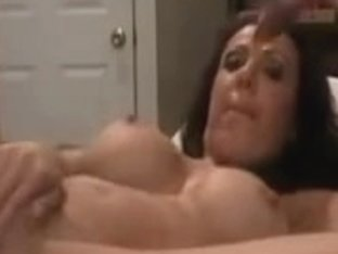 Busty MILF drills her slit with a dildo