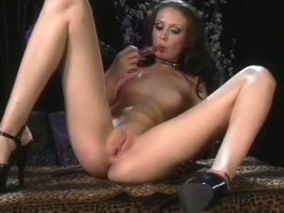 Slim Leggy Brunette With Glass Dildo