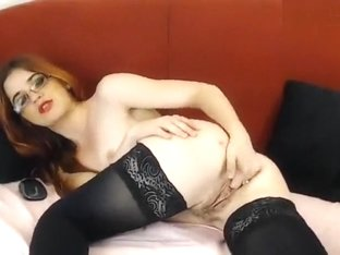 Redhead FireGirlAlice fucks her pussy with two fingers