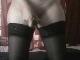 Hawt woman with shaved love tunnel and black stockings masturbates