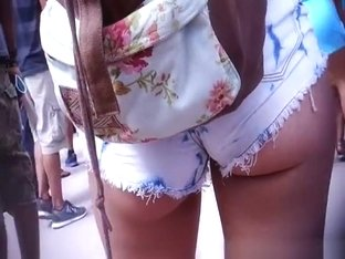 Girl in tight jeans shorts great ass