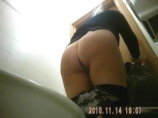 Classy blonde mature urinates in public bathroom video