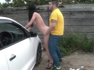 Naked blindfolded milf bent over the car and banged